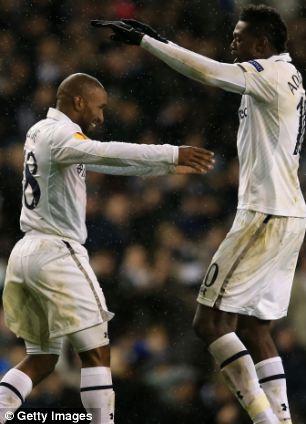 Defoe and Adebayor celebrate a goal against Panathinaikos in the Europa League