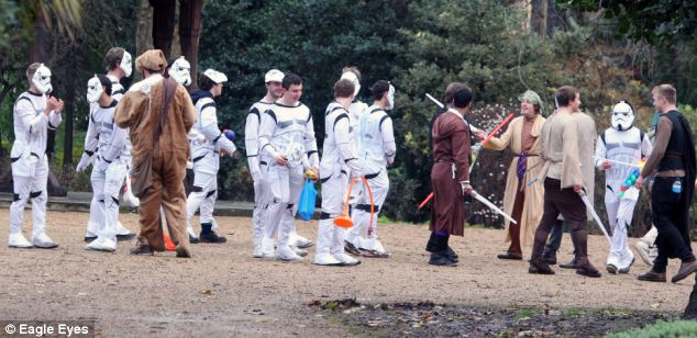 May the force be with you: A group of Stormtroopers laugh as they watch their friends mess about