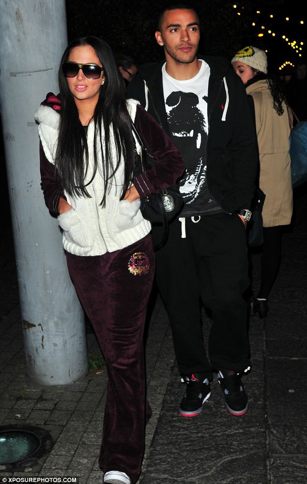 Shady lady: Tulisa tried to go unnoticed at one point by covering her eyes with a large pair of sunglasses