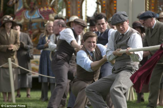 Family tension: Tom Branson (centre played by Allen Leech) and servant Jimmy Kent (right played by Ed Speleers) play tug of war as tensions build up between the two tribes