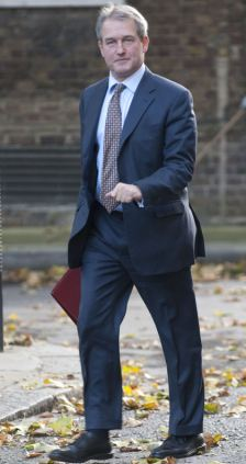 Owen Patterson, Enviroment Secretary arrives for a cabinet meeting at no.10 Downing Street.