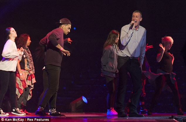 Upbeat: Christopher was seen practising with a number of dancers for his performance on Saturday