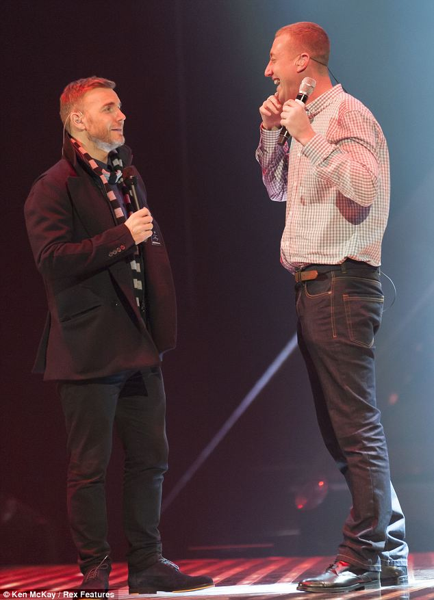 Despite fears over his voice Christopher looked very upbeat while on stage with Gary Barlow