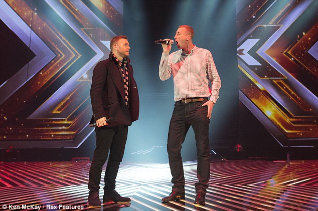 Gary Barlow appears to be slightly concerned watching Chris perform, it's thought he hasn't managed to get through a whole song