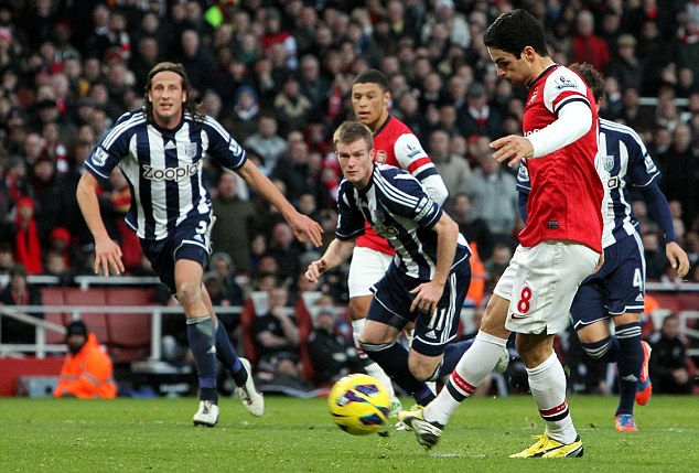 Easy as that: Mikel Arteta scored his first goal from the spot