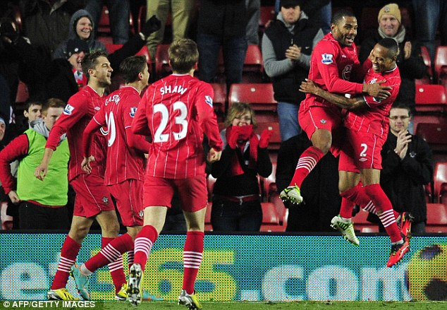 Sky high: Jason Puncheon (second right) celebrates with Southampton teammate Nathaniel Clyne