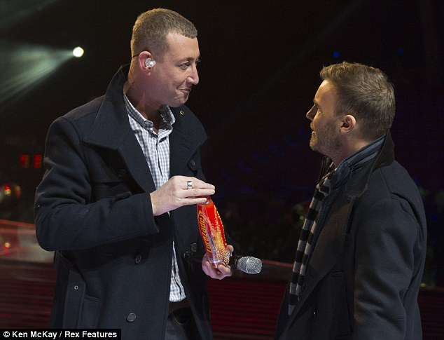Words of wisdom: Christopher was seen holding a bottle of Lucozade as he chatted to his famous mentor