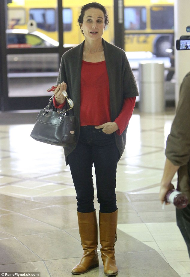 Natural beauty: Andie MacDowell showed off a make-up free look as she made her way through Los Angeles LAX Airport
