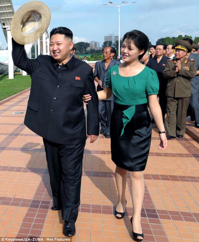 Smiling tyrant: Kim Jong-un, pictured with his wife Ri Sol-ju, is spending millions on the hotel whilst the North Korean population starves