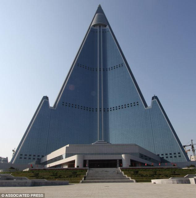 Giant hotel: The pyramid-shaped, 105-story Ryugyong Hotel stands in Pyongyang, North Korea, has 3,000 rooms and is set to open to the public next summer - after 25 years of construction