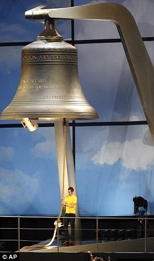 For whom the bell tolls: British cyclist Bradley Wiggins ringing the 23-ton bell to officially mark the start of the Olympic games in London