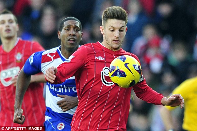 Eyes on the prixe: Adam Lallana looks to control the ball