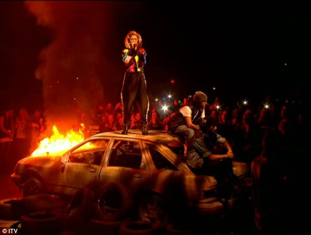 What a show: Rita stood on top of a burning car at the beginning of her performance