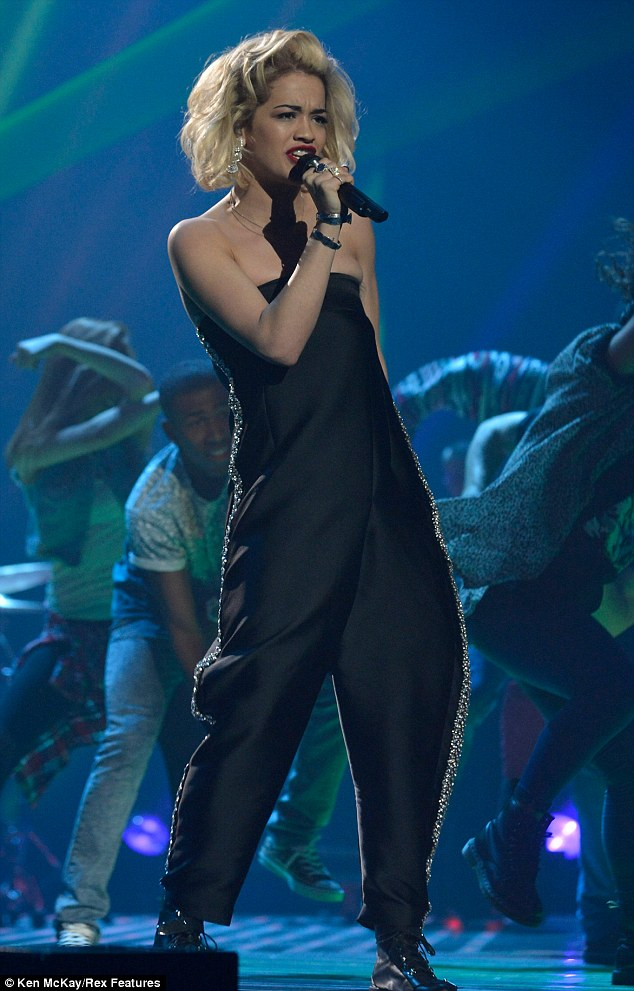 Still on top: The British singer seemed unfazed by the Twitter claims and performed a mash-up of her two smash hits