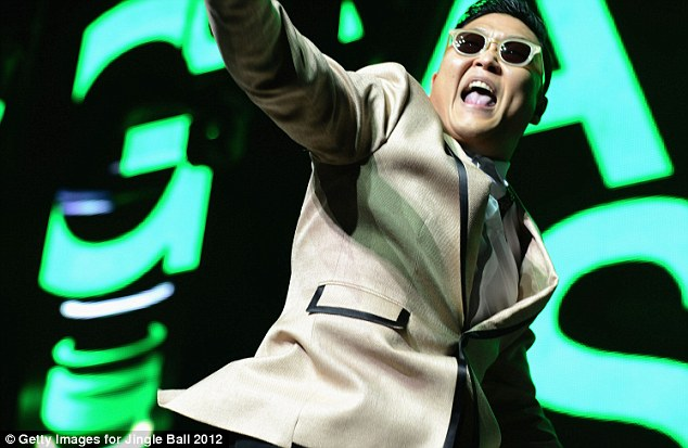 Still on: PSY, pictured performing yesterday in Miami, will still perform in tonight's 'Christmas in Washington' concert, slated to air on TNT December 21