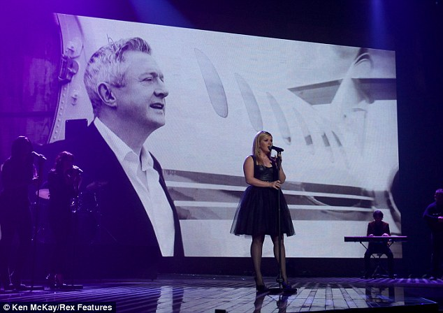 Best bits: Kelly performed against a montage of X Factor's best moments of the series