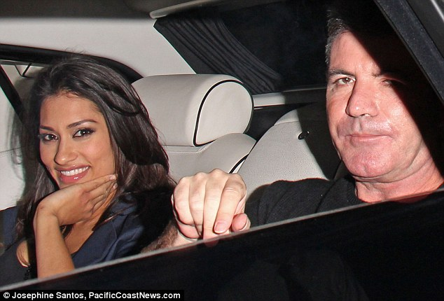 'Trouble': Simon Cowell leaves LA's trendy Cecconi restaurant with True Blood beauty Janina Gavankar on Saturday night