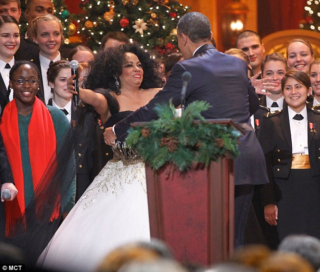 Merry Christmas Mr President: Obama appeared to struggle to get close to the star performer at the end of the Christmas in Washington concert