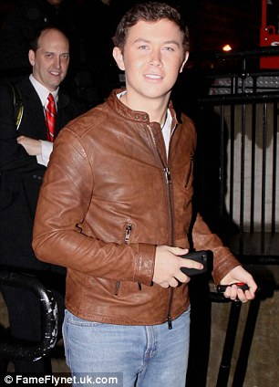 Festive mood: Scotty McCreary lookedcheerful as he left the event, while Psy and Conan O'Brien posed for photographs