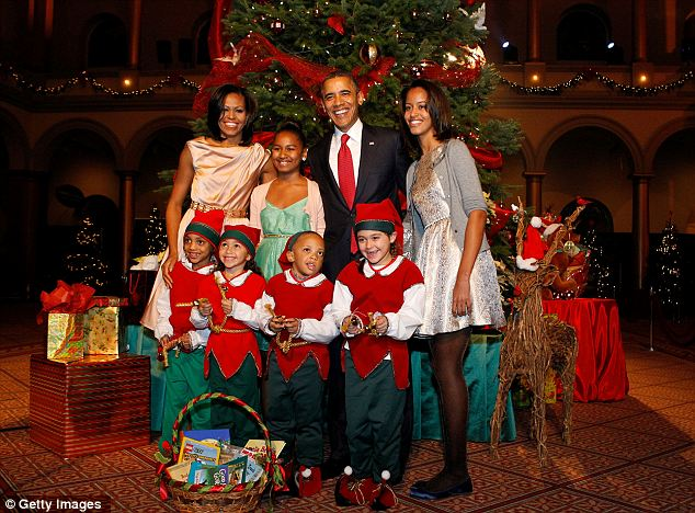 Happy Holidays: The Obama family posed with children dressed as elves from the National Childrens Medical Center