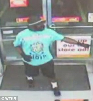 Police say this man entered the store carrying a gun when Mr McClean, an Air Force veteran, stepped out to his car to grab his glock .40 handgun from his car