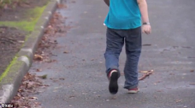Returning home: The 11-year-old boy cooly walks home after denied an opportunity to speak to a reporter due to his age