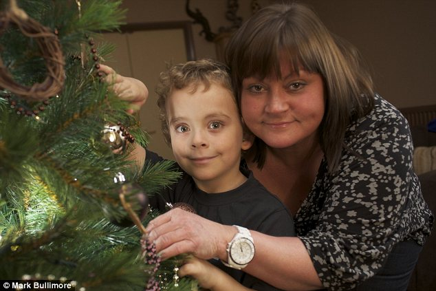 Theo and mother Bree with a fake Christmas tree. Both could go into anaphylactic shock if exposed to real pine needles