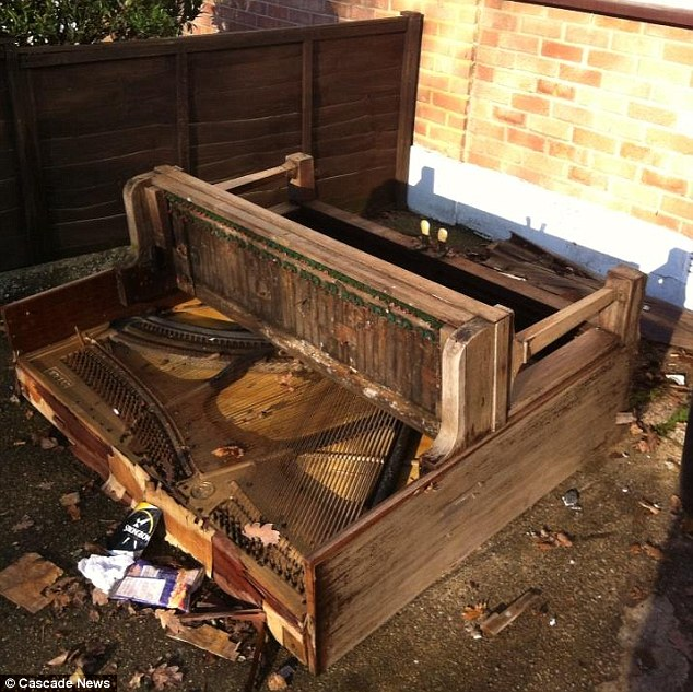 Discord: A piano was smashed up in the front garden before police dispersed the rowdy youngsters