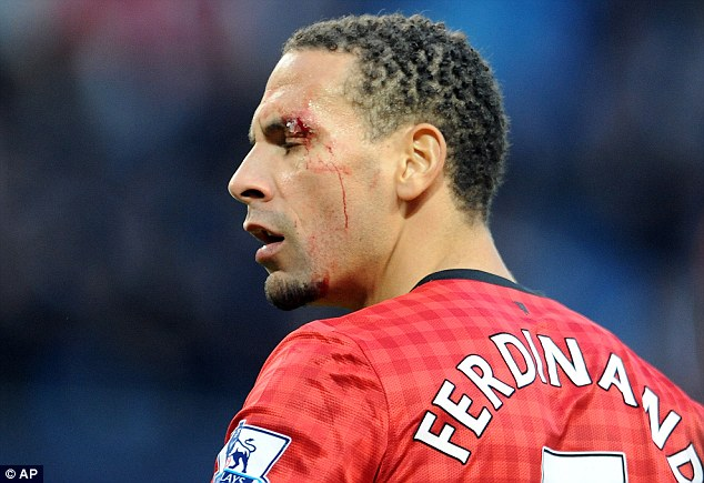 Flashpoint: Rio Ferdinand was hit with a coin as Manchester United won the derby at the Etihad Stadium