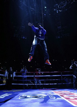 Is it a bird? Is it a plane? No it's 50 Cent! The rapper is lowered to the ring before the fight