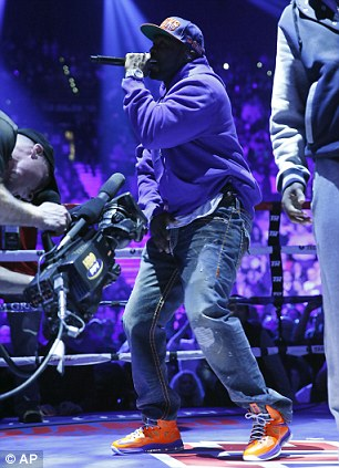 Is it a bird? Is it a plane? No it's 50 Cent! The rapper in the ring before the fight