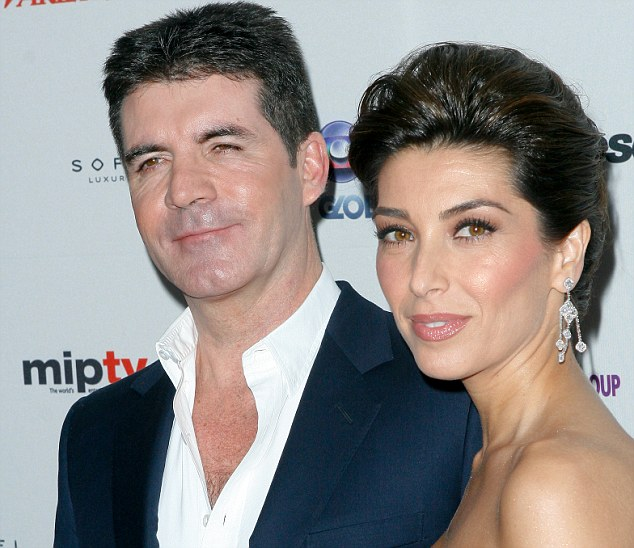 Dead ringer: Simon Cowell and ex-fiancee Mezhgan Hussainy at the 38th International Emmy Awards in New York in 2010