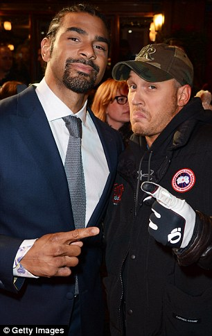 Casual occasion: Tom, who dressed down in jeans for the premiere, posed up with famous faces inside including I'm A Celebrity star David Haye