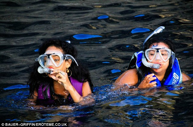 Scuba time: Even when snorkelling Rihanna was in full make-up and with her customary bling