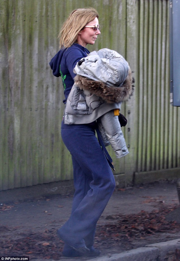 Look at me: Spice Girl Geri Halliwell cut a casual figure as she was seen on Tuesday morning in north London