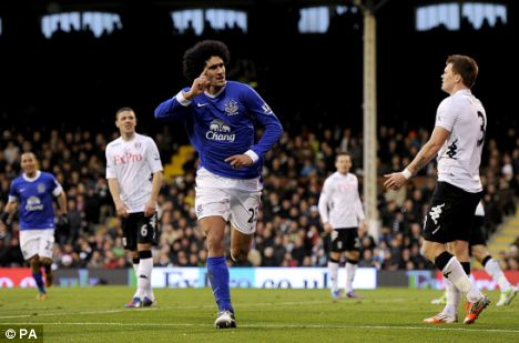 The Belgian midfielder celebrates scoring against Fulham in a 2-2 draw at Craven Cottage
