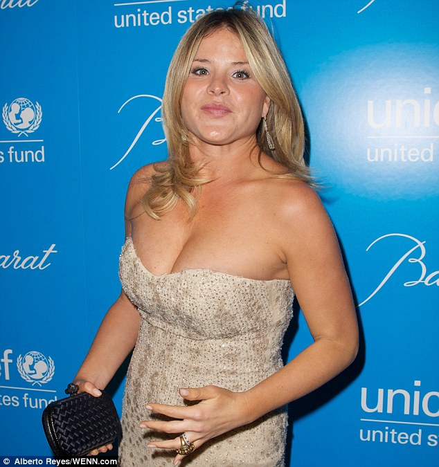 Tummy: Jenna Bush Hager placed her hand over her stomach as she posed for pictures at the UNICEF Snowflake ball last month