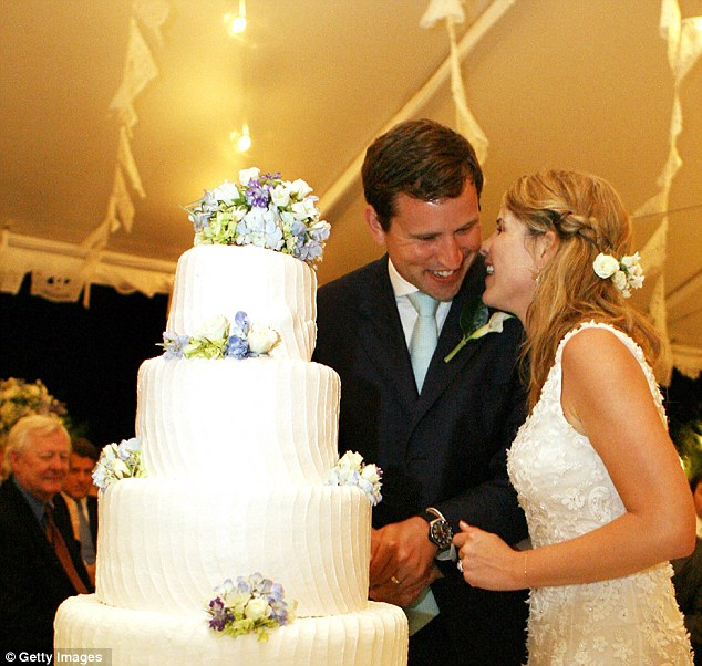 Tender moment: Jenna Bush Hager and husband Henry Hager share a joke as they cut their wedding cake