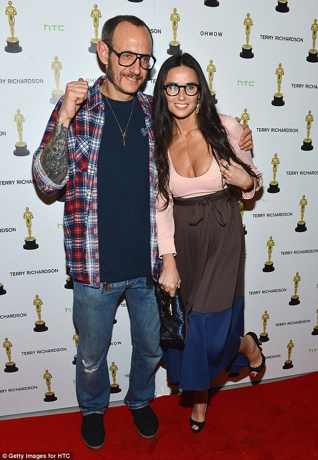Fashion faux pas: Demi Moore, meanwhile, raised eyebrows with her wild antics in Miami and drew stares at a bash last week for photographer Terry Richardson, pictured here, when she started acting goofy