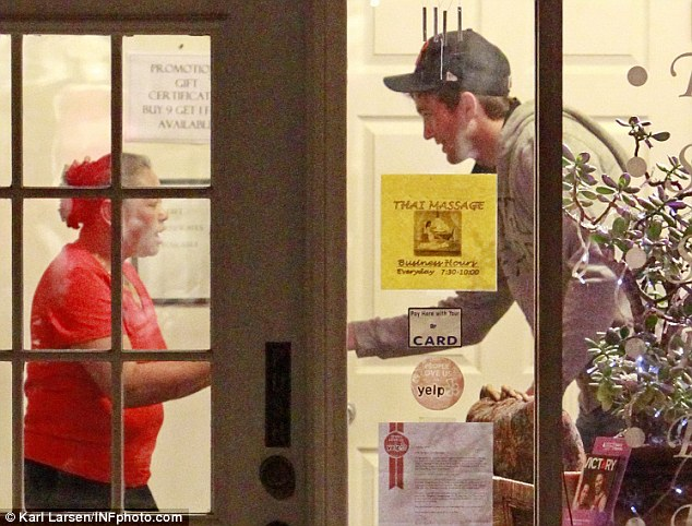 Well pleased: Ashton tipped the masseuse and left with a big smile on his face