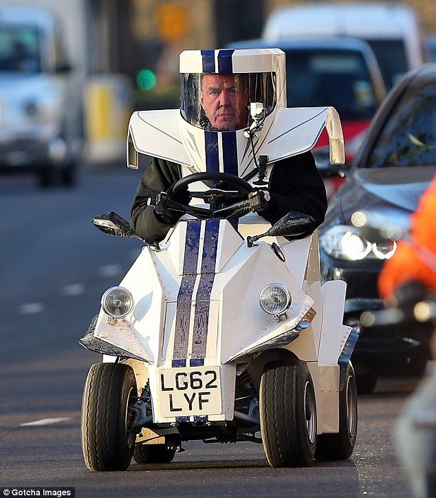 Space man: Jeremy Clarkson drives around in a futuristic toy-like car in London's Mayfair