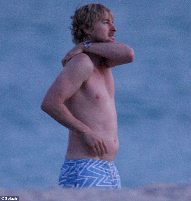 Middle-aged spread? Owen Wilson seemed to be packing a slight paunch as he kicked back on the beach in Miami, Florida