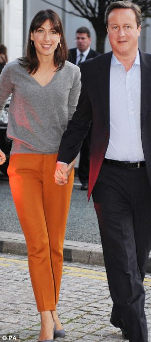 Zara fan: Label took centre-stage at the Tory party conference when Samantha Cameron wore a grey jumper (£29.99) and high-waisted orange cigarette pants (£39.99) from the same store