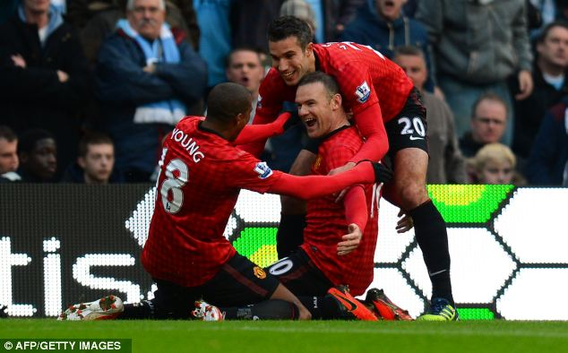Leaders: United won an explosive Manchester derby on Sunday to move six points clear at the top of the Premier League