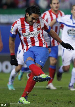 Atletico de Madrid's Radamel Falcao from Colombia scores his goal
