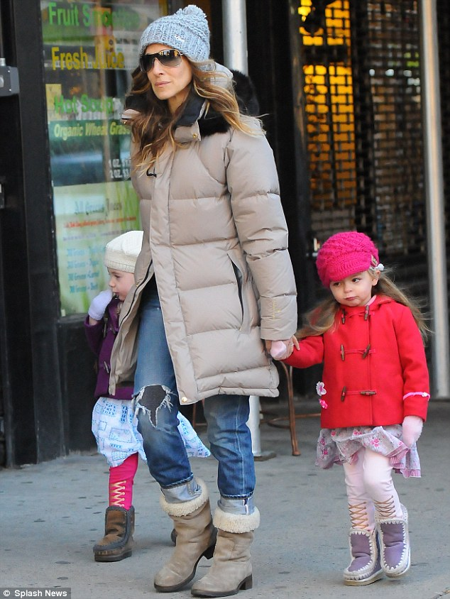 Colourful trio: SJP was rugged up in a puffer jacket and hat, while her girls donned bright coats and hats too