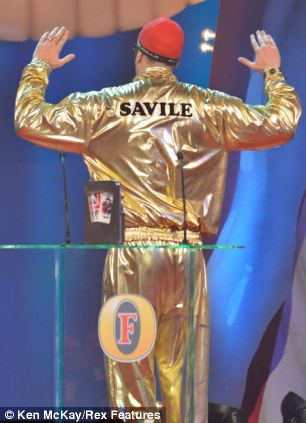 An Outstanding Achievement is handed to Sasha Baron Cohen, presented by Sir Ben Kingsley