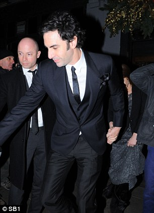 Celebrate: Baron Cohen and wife Isla Fisher pictured leaving London's Groucho Club after the awards ceremony