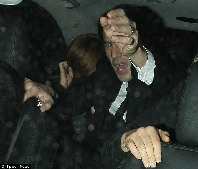 Boyakasha!: Cohen appears to angrily gesticulate at the camera as the couple leaves the venue
