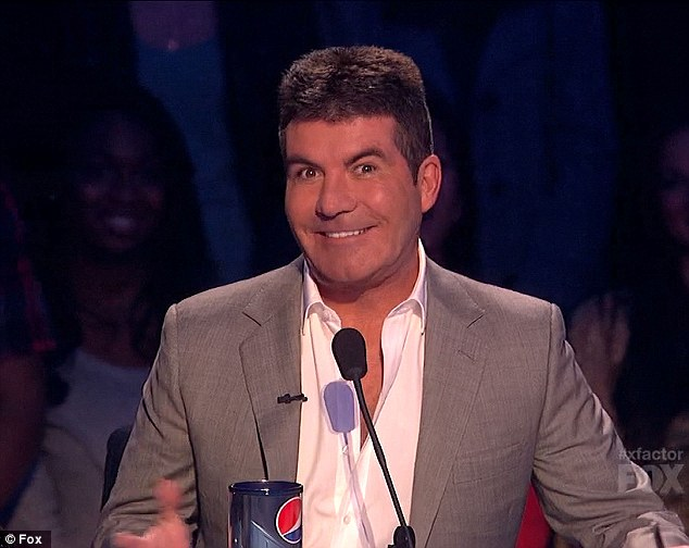 Looking puffy: Simon shows off his chubby cheeks during Wednesday night's live show